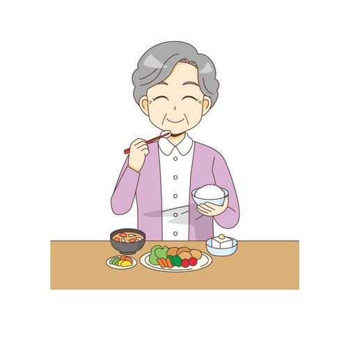 食事をする笑顔の女性高齢者(食事・食事介助/介護・生活)のイラスト