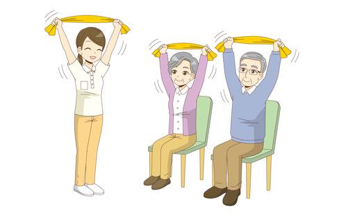 椅子に座ったままできるタオルを使った体操を行う高齢者(運動・椅子体操/介護・生活)